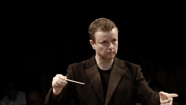 conducting an orchestra - conductor stock videos & royalty-free footage