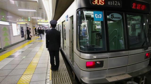 conductor at subway train - bahnreisender stock-videos und b-roll-filmmaterial