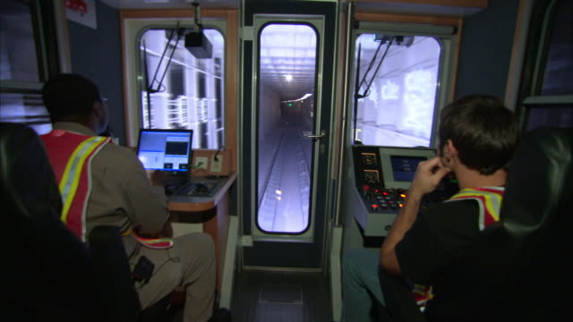 a conductor controls a subway train. - transport conductor stock videos & royalty-free footage