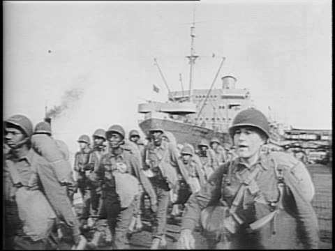 conductor directs band playing on dock with ship in background / ship with soldiers waving from deck / ship steams away from dock / soldiers march on... - allied forces stock videos & royalty-free footage