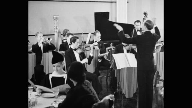 conductor leading musicians in small orchestra in nightclub - sheet music stock videos & royalty-free footage