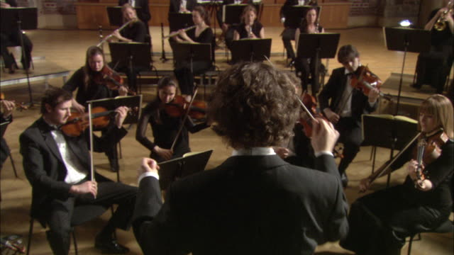 ms conductor leading orchestra / london, united kingdom - directing stock videos & royalty-free footage
