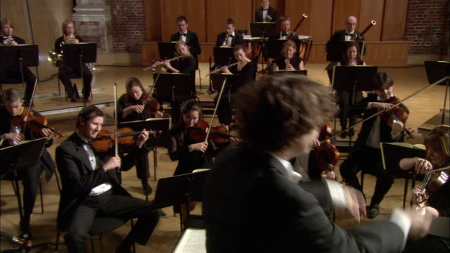 ms conductor leading orchestra / london, united kingdom - conductor stock videos & royalty-free footage