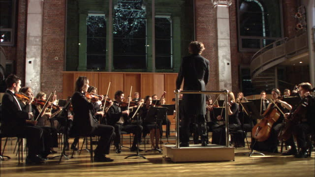 ws conductor leading orchestra / london, united kingdom - orchestra stock videos & royalty-free footage
