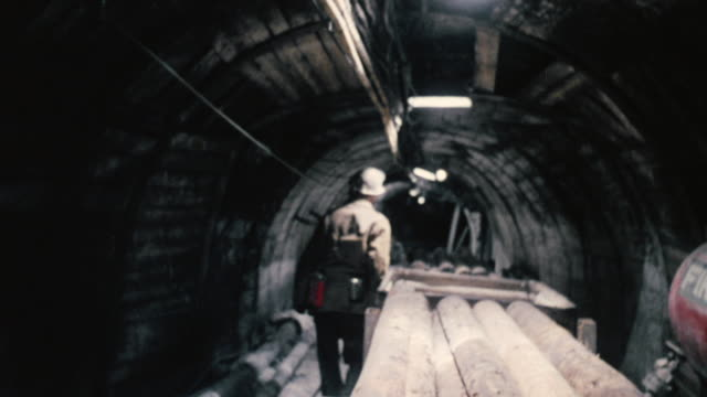 MONTAGE Conductor pulling pullwire to stop mining carts from hauling / England, United Kingdom