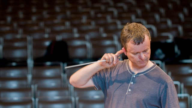 conductor rehearses orchestra - musical conductor stock videos & royalty-free footage