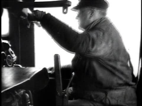 1923 reenactment conductor riding in train looking out and blowing whistle / united states  - 1923 stock videos & royalty-free footage