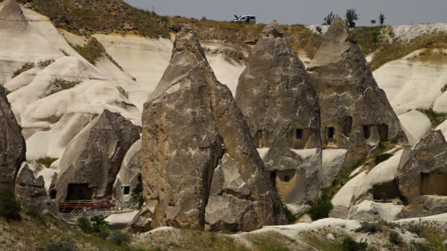 cone-shaped rock formations with openings - iran stock videos & royalty-free footage