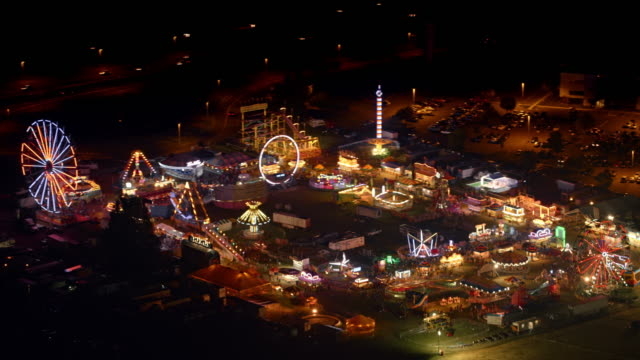 aerial coney island amusement park at night - fairground stock videos and b-roll footage