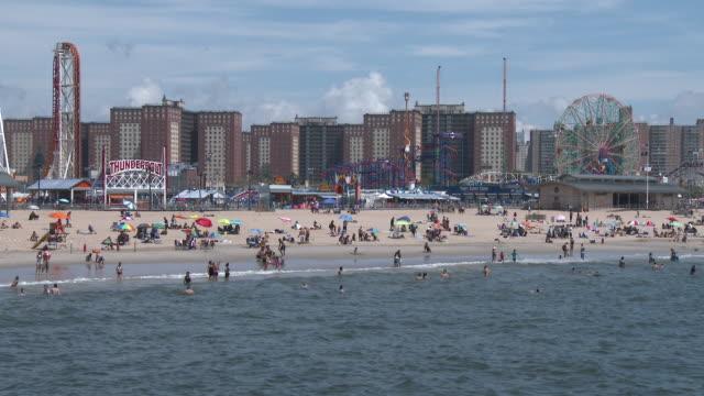 coney island beach sunbathers, luna park, wonder wheel - hot summer afternoon - scott mcpartland stock videos & royalty-free footage