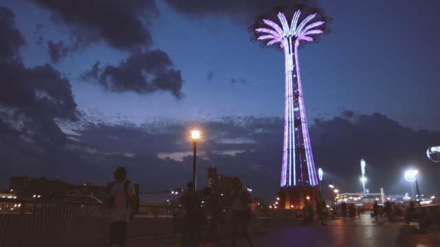 coney island establishing shot at dusk. - coney island brooklyn stock videos & royalty-free footage