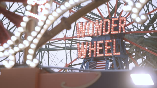 coney island ferris wheel - establishing shot - closeup - 4k - capital letter stock videos & royalty-free footage