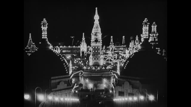 1917 coney island lights at night - coney island stock-videos und b-roll-filmmaterial