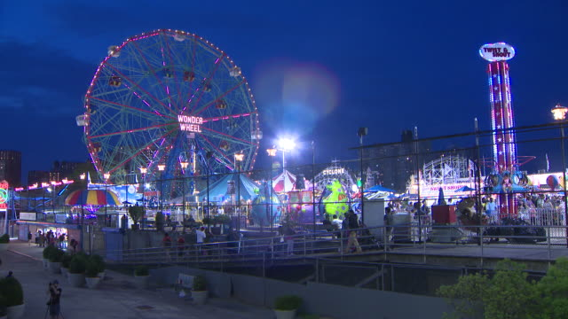 coney island rides and boardwalk at night. - coney island stock videos & royalty-free footage