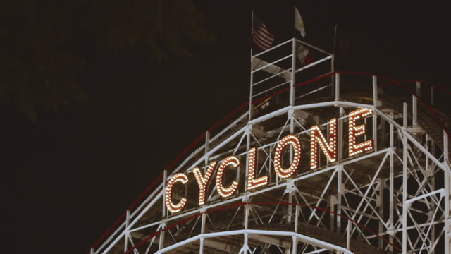 coney island's world famous cyclone roller coaster at night - 4k - capital letter stock videos & royalty-free footage