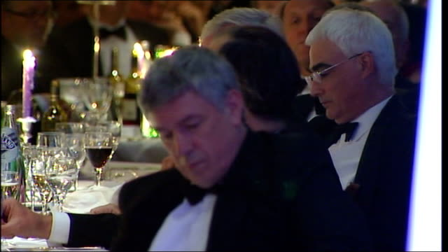 Confederation of British Industry annual dinner Alistair Darling arrival speech Guests businessmen seated around dinner tables during speeches /...