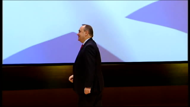 alex salmond extends scheme to help firsttime house buyers scotland perth int **music heard sot** alex salmond msp waving on stage at snp conference... - scottish national party stock videos & royalty-free footage