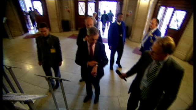 conference continues; england: london: westminster: ext ukip leader nigel farage mep farage sat talking to woman in wheelchair tv cameraman farage... - ボンドガール点の映像素材/bロール