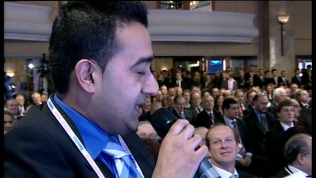 David Cameron speech Cameron at podium as Broughton and Lambert applauding / Audience applauding / Martin Broughton thanking Cameron SOT / Cameron...