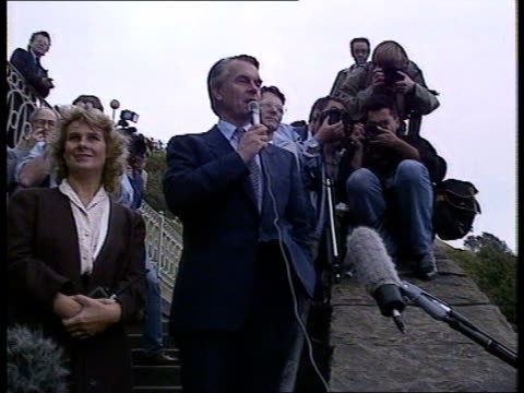 day 3 england scarborough drdavid owen sdp leader speaking to delegates on mike outside hall after all having been cleared out of hall after a bomb... - 英国スカーブラ点の映像素材/bロール