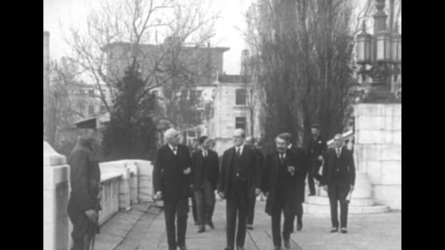 conference delegates walk down outdoor steps and toward camera / chinese delegate alfred sao-ke sze, british delegate arthur balfour, american... - documentary footage stock videos & royalty-free footage