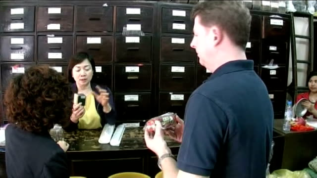 conference ends without agreement to curb trade in ivory and rhino horn tx hanoi reporter examining arfican rhino horn medicine for sale in shop ends... - rhinoceros stock videos & royalty-free footage