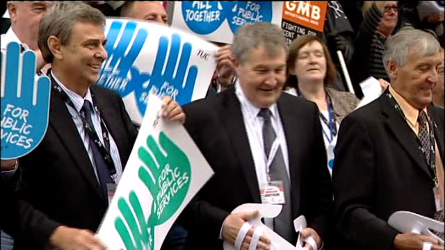 leaders threaten strikes against spending cuts; england: manchester: ext various views of trades union congress delegates posing for family... - trades union congress stock videos & royalty-free footage