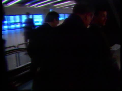 stockvideo's en b-roll-footage met conference on vietnamese boat people; switzerland: geneva: int conf on repatriation of boat people as delegates milling around american delegates... - repatriëring