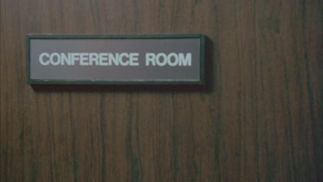 a conference room door closes. - office doorway stock videos & royalty-free footage