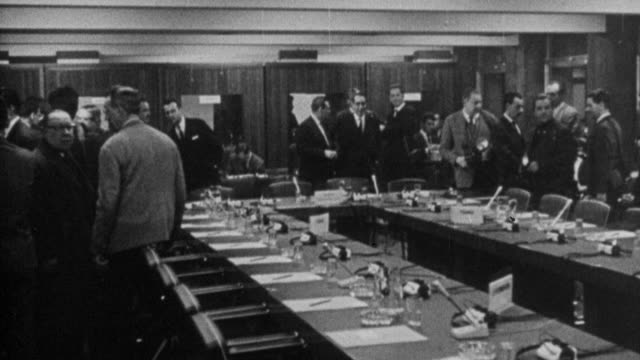 vídeos de stock, filmes e b-roll de 1973 montage conference room of the 1963 negotiations for the united kingdom to join the eec, and edward heath entering / brussels, belgium - 1973