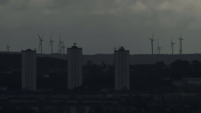 sturgeon announces new independence referendum bill scotland glasgow skyline shot wind turbines with obelisk in foreground birds along flying wide... - 国民投票点の映像素材/bロール