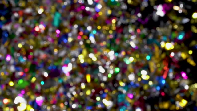 confetti explosion to camera on black background - fiesta background stock videos & royalty-free footage