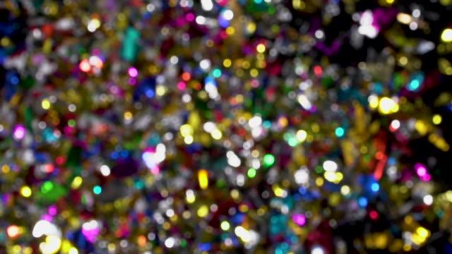 vídeos de stock e filmes b-roll de confetti explosion to camera on black background - confete