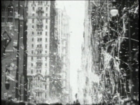 confetti falling in downtown as parade for lindbergh progresses down the street and police keep crowd back / new york, new york, united states - 1927 stock videos & royalty-free footage