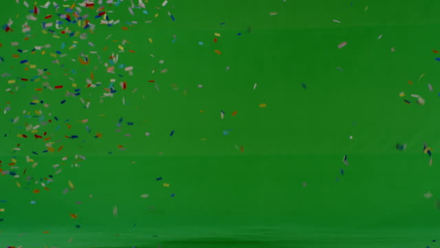 confetti falling on green - confetti stock videos & royalty-free footage