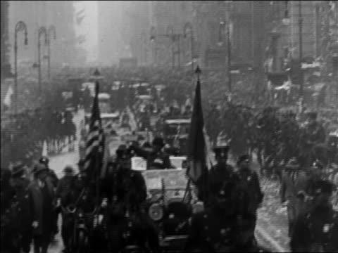 B/W 1928 confetti falling on parade on NYC street / titles read 'New York' / documentary