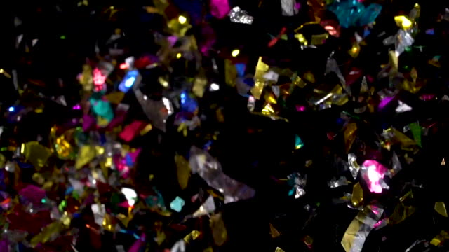 confetti flying in mid air on black background - streamer stock videos & royalty-free footage
