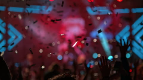 slo mo confetti raining at a night concert - concert stock videos & royalty-free footage