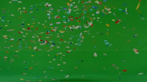confetti shower on green - konfetti bildbanksvideor och videomaterial från bakom kulisserna
