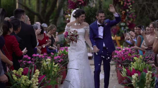 confetti throwing on happy newlywed couple - christianity stock videos & royalty-free footage