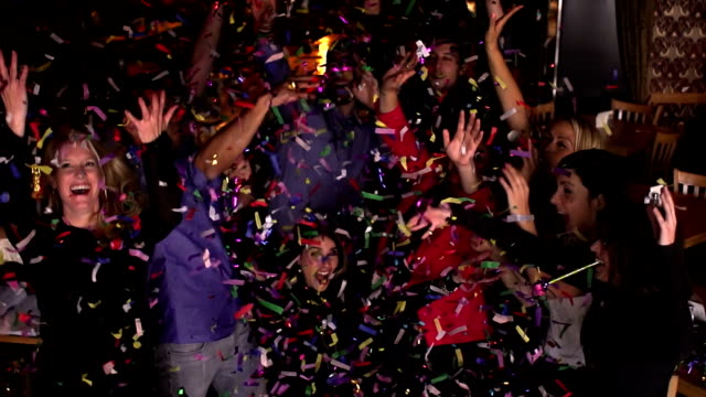 vídeos de stock e filmes b-roll de confetti young adults colleague party bar - montage - contente