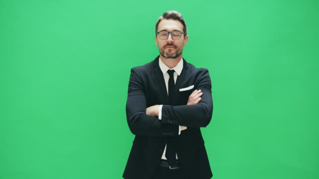 confidence and a great suit will take you places - green background stock videos & royalty-free footage