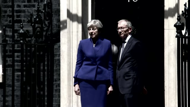 'confidence and supply' agreement struck between conservatives and the democratic unionist party lib ext various graphicised theresa may mp and... - husband stock videos & royalty-free footage