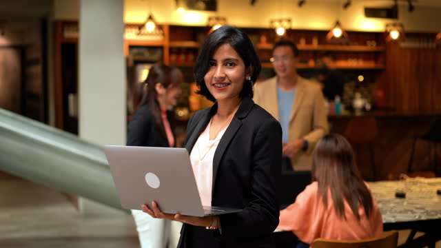 confidence indian businesswoman using laptop in co-working space - indian ethnicity stock videos & royalty-free footage