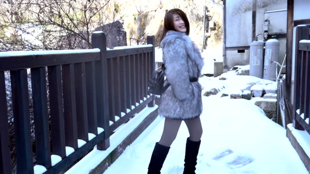 confidence woman dancing with excitement in the cold weather - only japanese stock videos & royalty-free footage