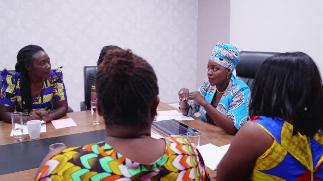 confident african businesswoman chairing a annual sales review meeting - colleague help stock videos & royalty-free footage