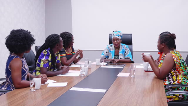 confident african businesswoman chairing a staff meeting - zambia stock videos & royalty-free footage