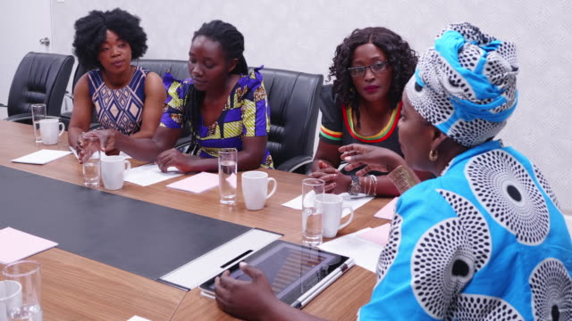 confident african businesswoman giving advice to her staff in a boardroom meeting - zambia stock videos & royalty-free footage