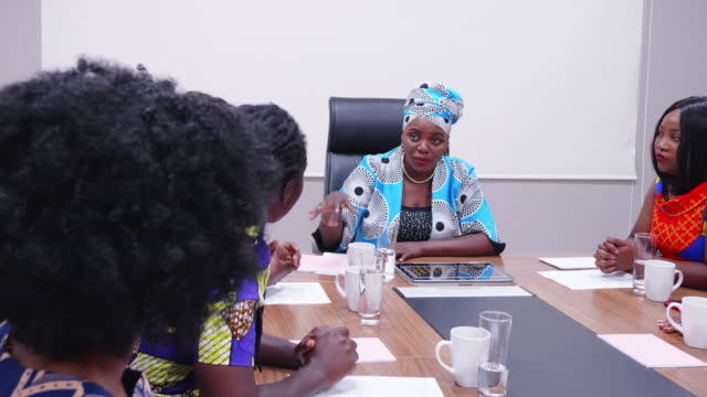 confident african businesswoman mentoring her team members - colleague help stock videos & royalty-free footage
