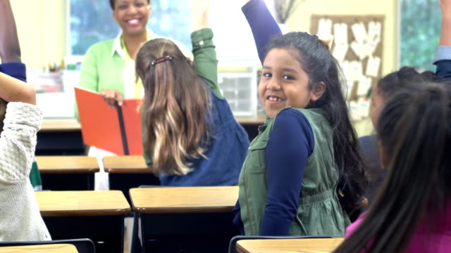 confident african-american girl in classroom - hand raised stock videos & royalty-free footage